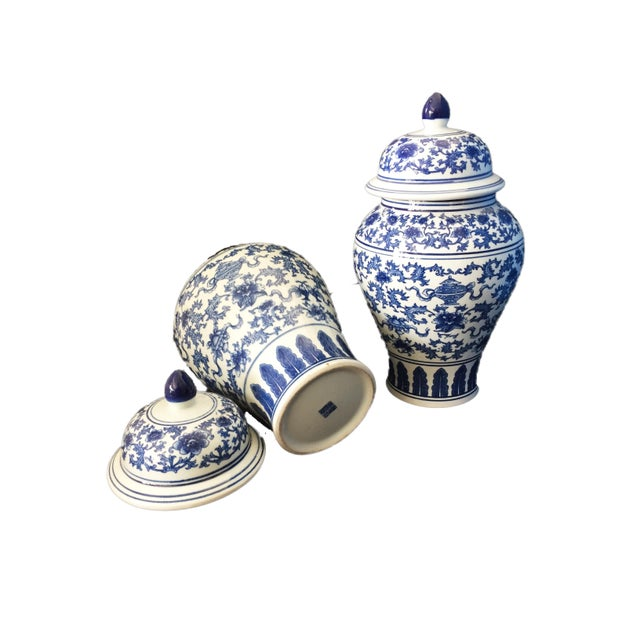 Superb blue and white covered ginger jars with floral motif ,and auspicious symbols for good luck feather on the base...