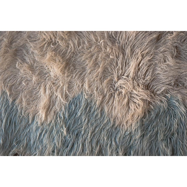 A stunning densely woven wool rya rug in a light blue and off-white abstract design that is so representative of the era....