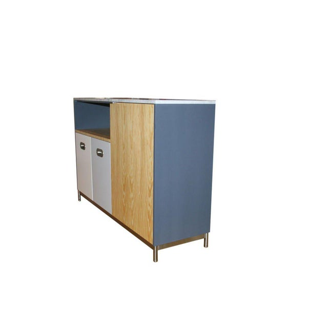 Mn Originals utility island cabinet on solid brushed stainless steel base. Southern Pine Veneer contrasted with matte...