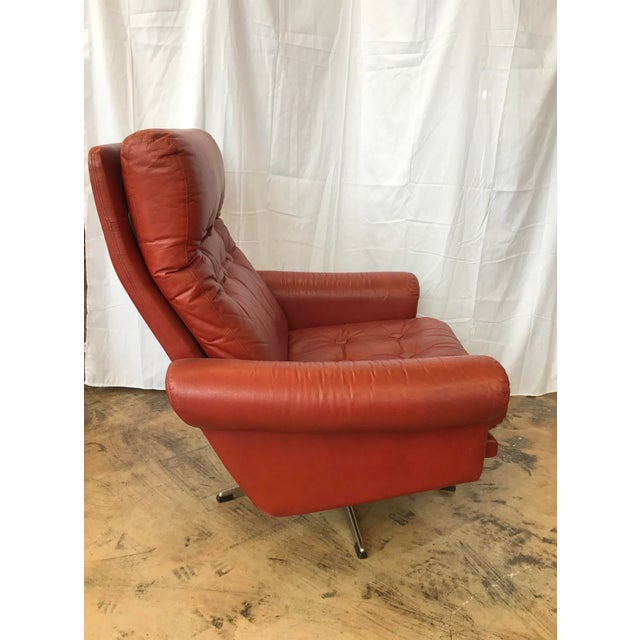 1960's all leather red swivel chair with tufts, square buttons metal base. This chair is so comfortable with the extra...