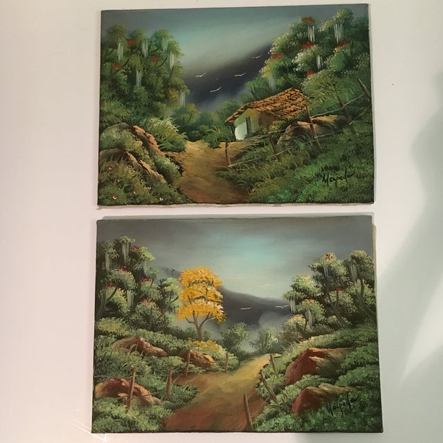 A pair of vintage hillside paintings on canvas. Signed Wecpeda?