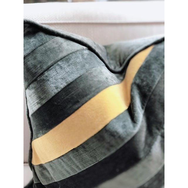 Utterly modern with a retro vibe, hand-pieced diagonal stripe down filled throw pillow with a grey, solid color velvet...