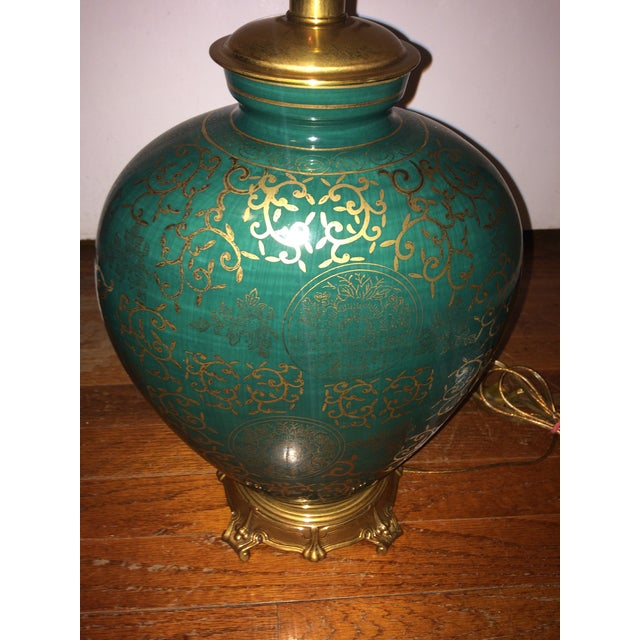 Cannot find one like this anywhere. A rare beauty in near perfect condition. The green and brass lamp has an intricate...