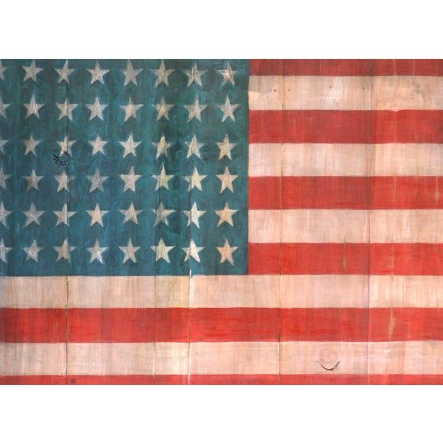 Painted American flag on old wood. A beautiful piece of rustic art that shows you are a patriot as well. Unique!