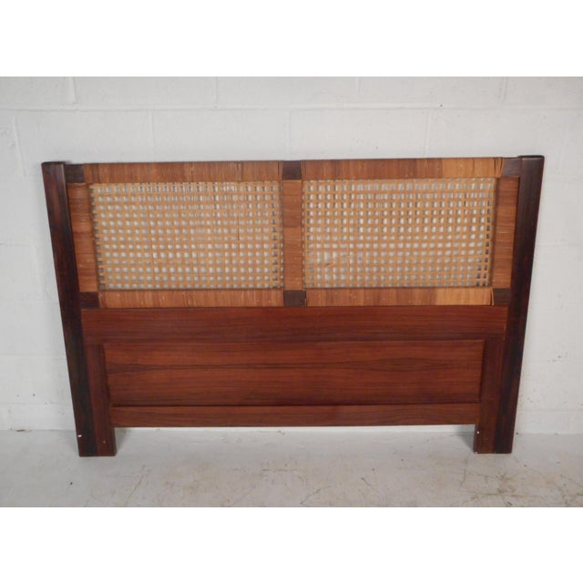 This impressive Danish modern headboard features a rosewood frame and a woven cane centerpiece. This stylish queen sized...