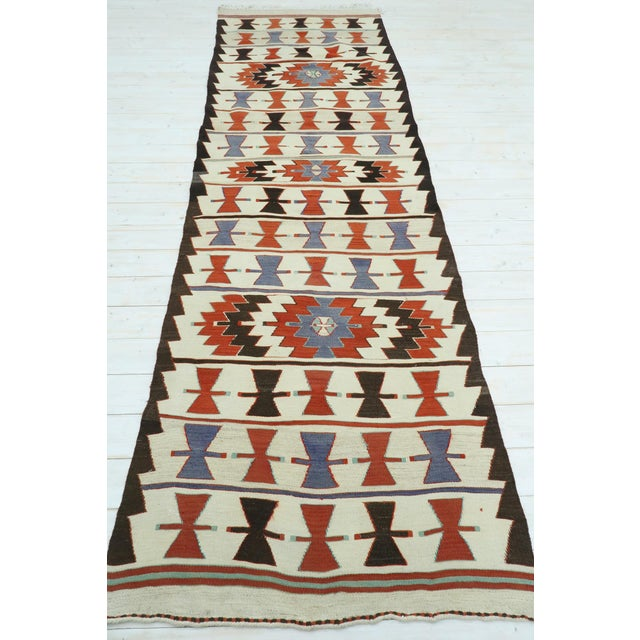 Beautiful vintage Turkish kilim runner rug made pure handspun wool and dyed naturally. Beautiful colours. this vintage...