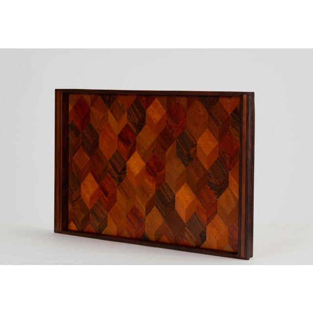 A rosewood tray by Don Shoemaker for Señal, designed and produced in Mexico, featuring a stunning geometric inlaid...