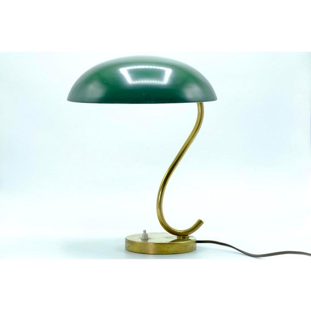Decorative Scandinavian Mid-century table lamp in brass and green plaque. Beautiful swirl design to the lamp gives it a...