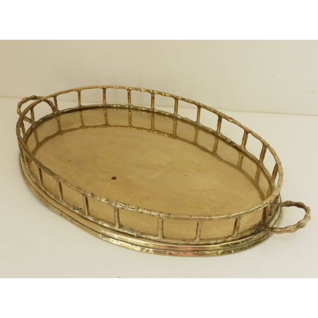 Lovely oval brass tray with a bamboo style design. Can be used as a dresser tray or displayed on the coffee table. Never...
