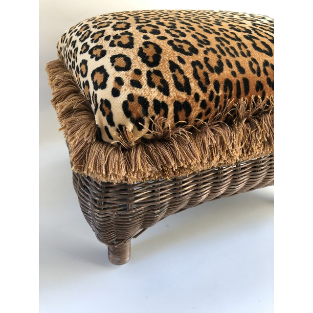 Vintage wicker stool lacquered in silver with gold-tone exterior newly upholstered in a velvet leopard with brush fringe...