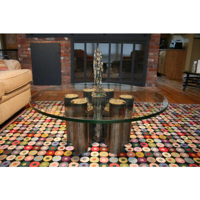 Brutalist artillery shell table and matching chandelier made by Post War artist Eddie Garfinkle in 1970. The table...