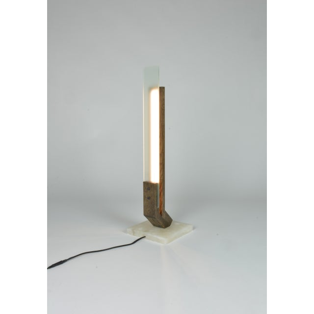 Oak table lamp with acid-etched glass and alabaster table. This lamp has a parallel arm configuration creating negative...