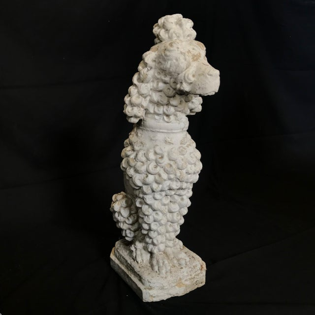 A charming vintage stone French Poodle dog sculpture in an obedient seated pose with fantastic weathered patina. An...