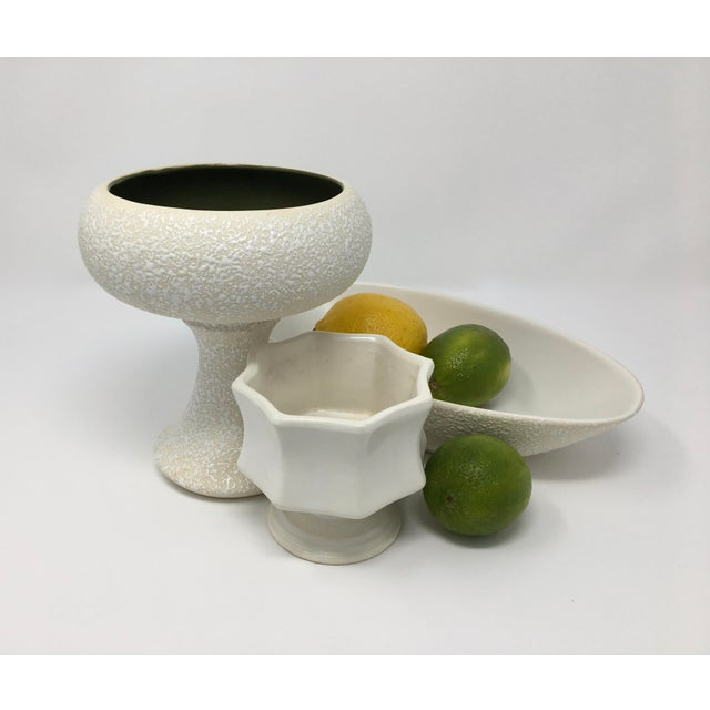 Three mid-century ceramic pieces of various sizes and uses will add cool beauty to your holiday parties and winter...