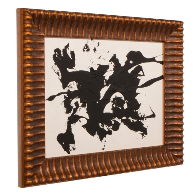 Original mid-century style black and white abstract painting with gold bronze colored heavy frame. The mixed media...