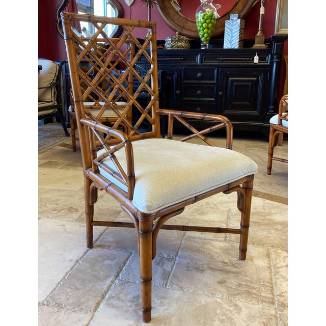 Set of 8 rbamboo dining chairs in the style of Elinor McGuire. The chairs have lattice backs and low arms. Curved leg...