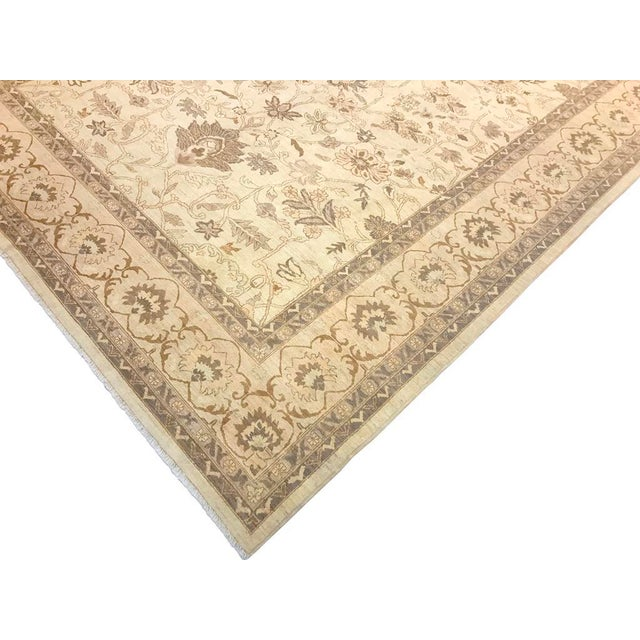 This beautiful sun faded traditional hand knotted rug adds sophistication and grace to any décor. Its exquisite continuous...