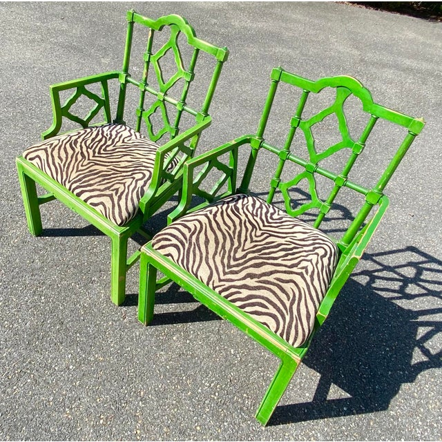 Amazing pair of Hollywood Regency pagoda chairs. Done in a bright green with zebra upholstery. Made in Spain. These chairs...