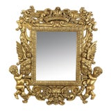 Image of French 18th Century Mirror in Carved Gilt Wood Frame With Putti For Sale