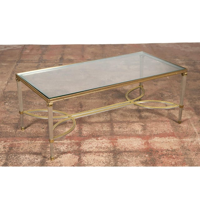 """Hollywood Regency mix metal bronze coffee table with glass top. Size: 41"""" wide x 21"""" deep x 17"""" high A beautiful piece..."""