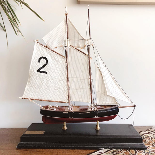 """Vintage wooden and brass ship model with fabric sails. The brass plaque on the base identifies the ship as """"New York Pilot..."""