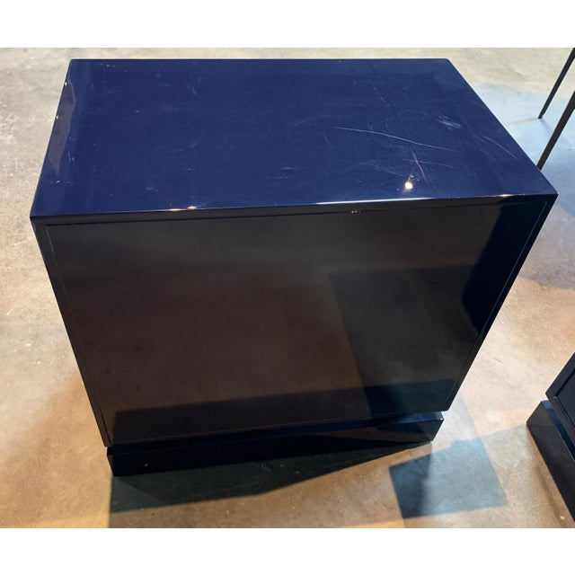 This lovely nightstand features a navy lacquer finish. The nightstand features a drawer on glides, two doors and a non-...