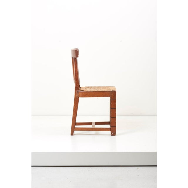 Set of six French 1930s wooden chairs in oak by Jacques Mottheau (1899-1981).