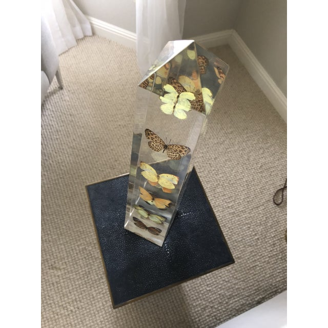 This is a vintage butterfly obelisk by Jonathon Adler. The retail price was $250.