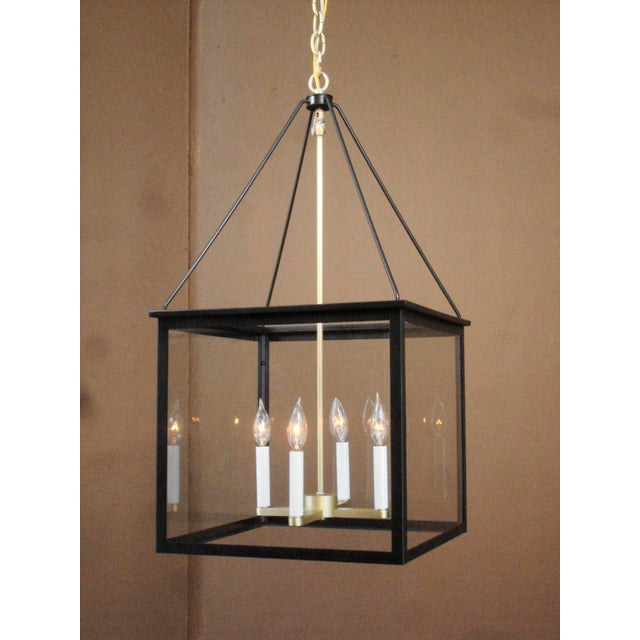 A classic take on a modern lantern in a brushed brass and black finish with clear glass, this is a great lighting fixture...