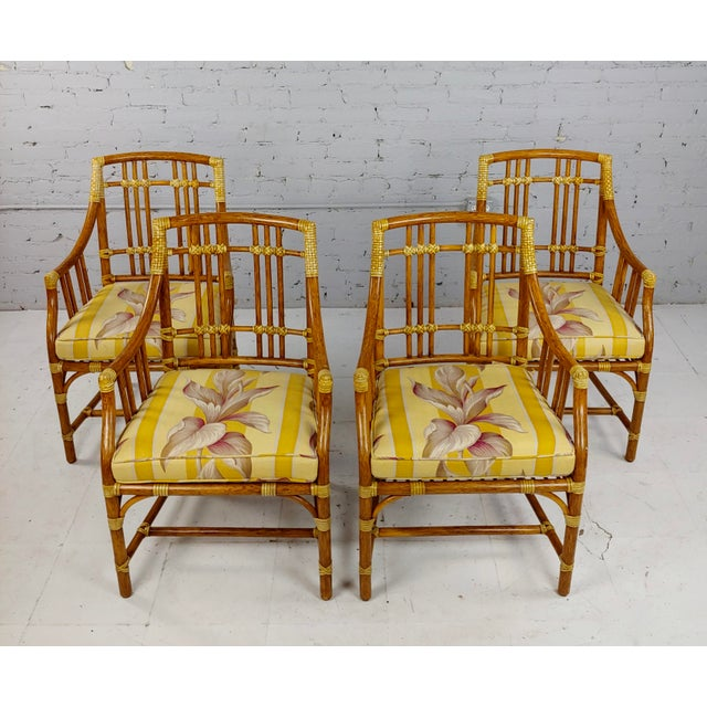 Vintage McGuire Rattan Dining Chairs - set of 4 Dimensions 34 1/2 in. high 22 1/2 in., outside arm to outside arm; 18 3/4...