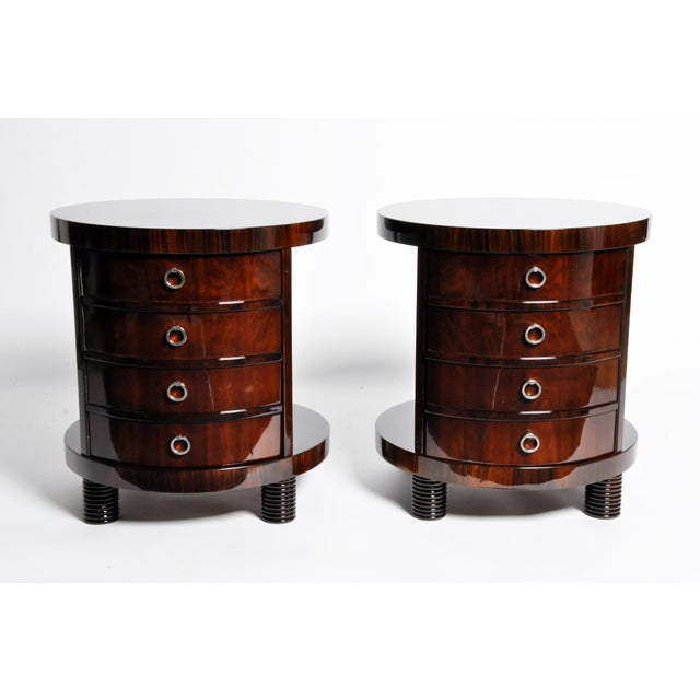 These elegant, newly made round side tables are from Hungary and are made from walnut veneer. The pieces feature false...