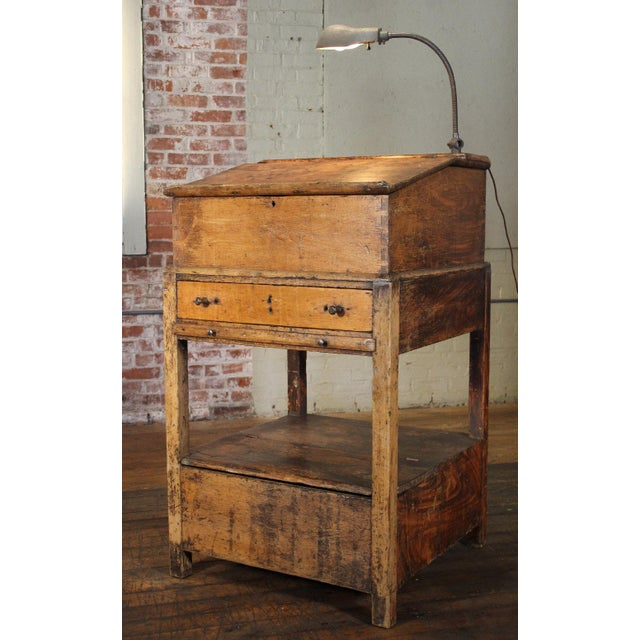 Host station with gooseneck light. Hinged top opens to reveal storage with small drawer and cubby holes, bottom opens for...