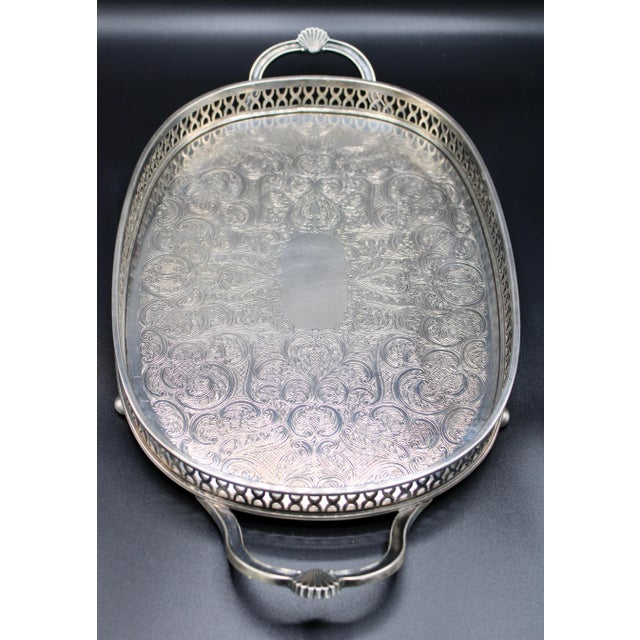 This is a stunning Art Deco style silver plated tray with handles and balled feet, made in England circa 1940. Clam shell...