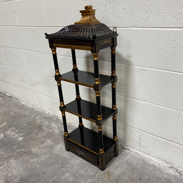 Super cute Pagoda style hanging wall shelf with single drawer. Excellent condition. High gloss black lacquer and gold...