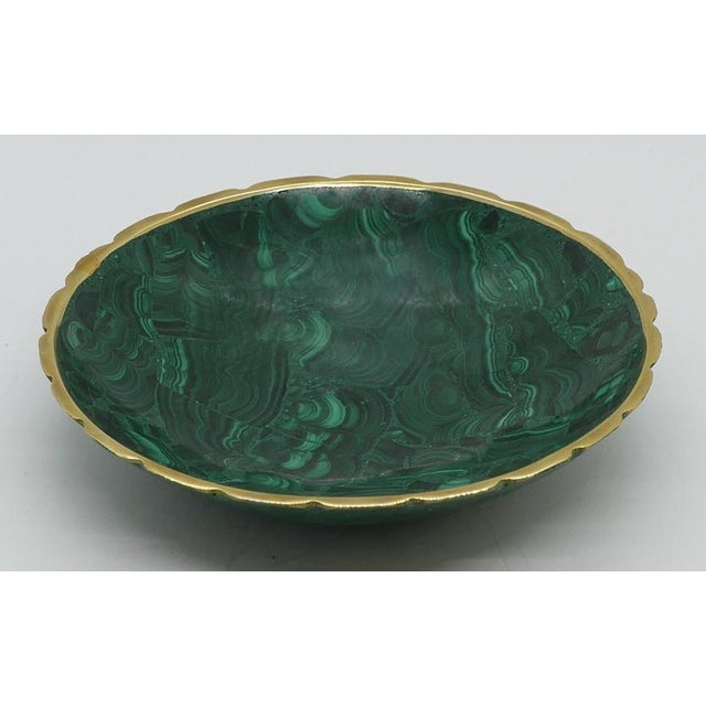 Vintage, polished malachite dish with brass trim. Architectural swirls enhance the malachite. Mid-late 20th century piece....