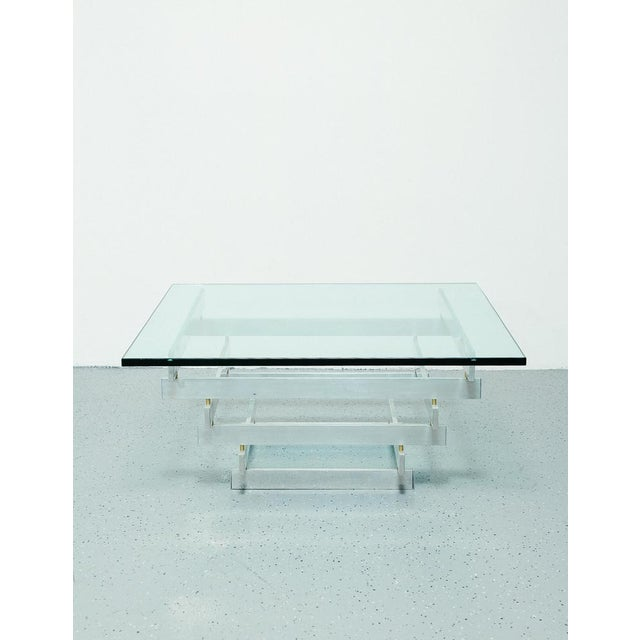 Sculptural coffee table deigned by Paul Mayen for Habitat. Aluminum frame and 3/4 inch thick glass top.