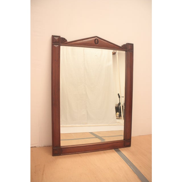 Beveled mirror with pediment and quadrilateral corners is beautifully design with simplicity yet elegant shape.