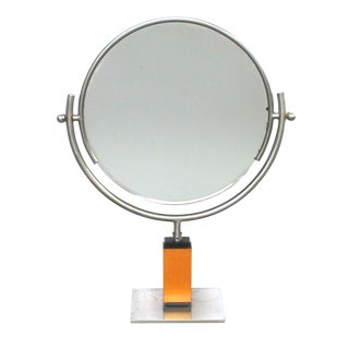 A Chic American Art Deco 1930's Steel Dressing Mirror Raised on a Maplewood Base With Ebonized Highlights For Sale