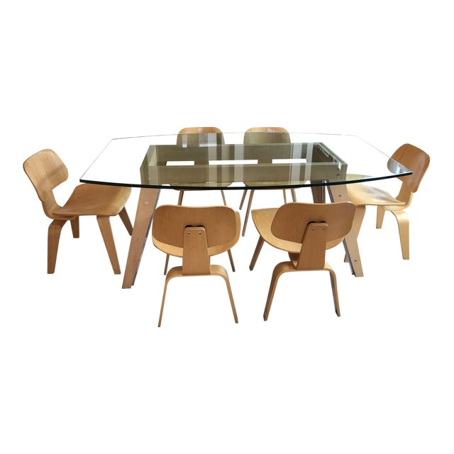 https://chairish-prod.freetls.fastly.net/image/product/sized/ee3a6950-08fc-4c18-92d8-2ddb71f7dd37/eames-by-herman-miller-lcw-mid-century-modern-glass-dining-table-and-chairs-set-3907?aspect=fit&width=640&height=640
