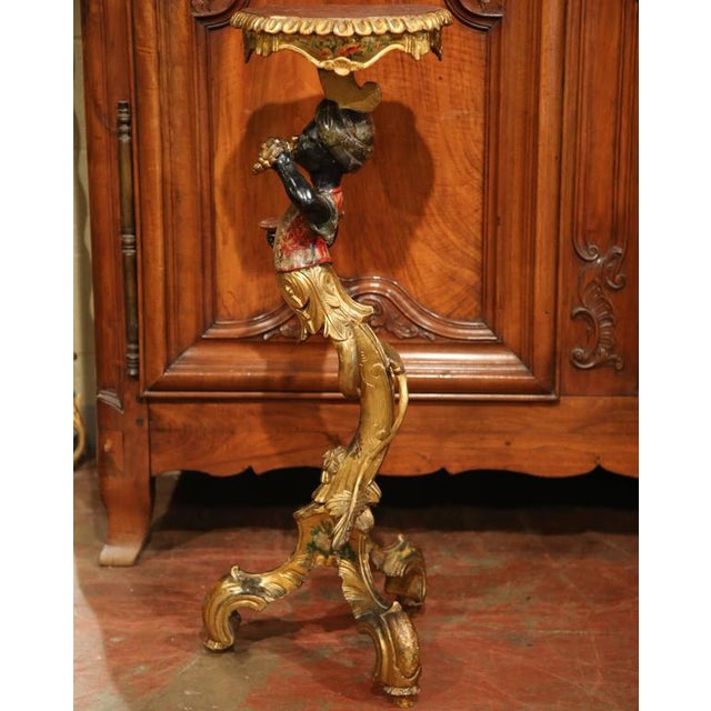 This intricate, antique hand-painted table was made in Italy, circa 1870. The Blackamoor boy is expressive and wears a...