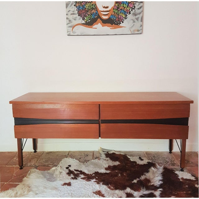 African teak wood, or Iroko hardwood Italian Mid Century Modern, dresser, with 4 large drawers. The dresser has 4 stylish...