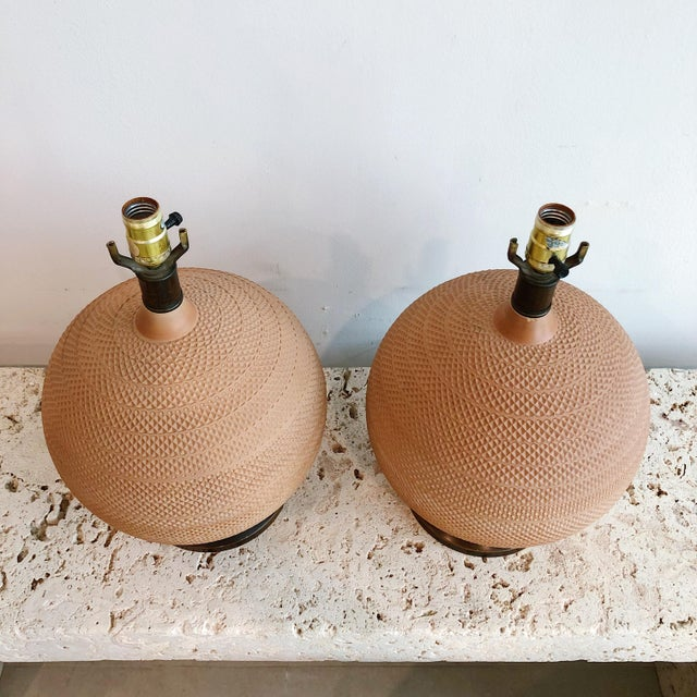 Stunning rare pair of spherical terra cotta table lamps by Mutual Sunset Co. Unsigned. With wood bases. Original wiring.