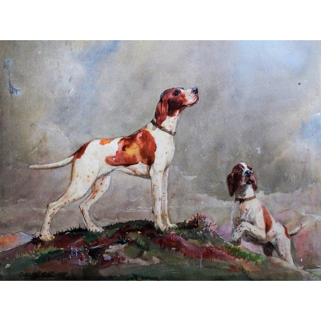 A fine English watercolor painting of 2 setter dogs on point in a colorful highlands landscape. It is an excellent example...