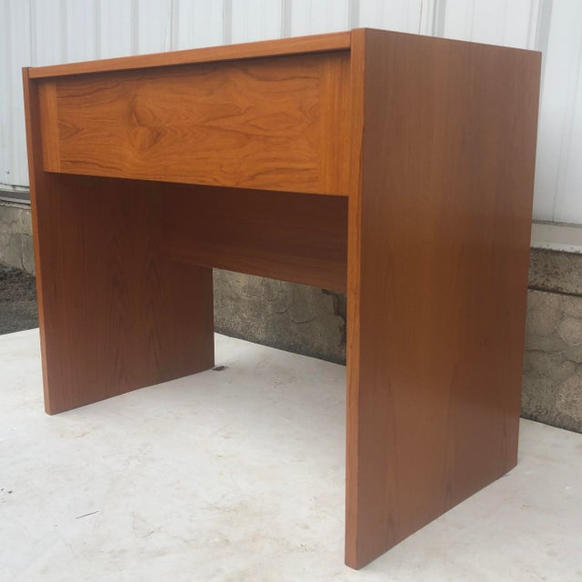 This unique vintage vanity features a pop-up vanity top with mirror and interior storage in a vintage teak finish. Perfect...