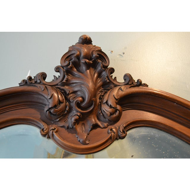 This is a beautiful old mirror that would do well above a mantel, console table or dresser.