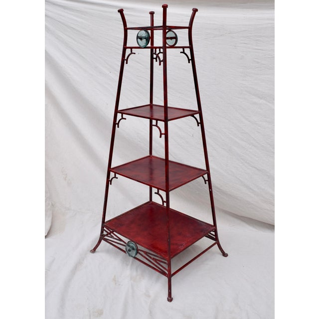 Substantial iron four tier Etagere by Palecek. Marvelous Chinoiserie tapered pagoda motif with striking red finish & hand...