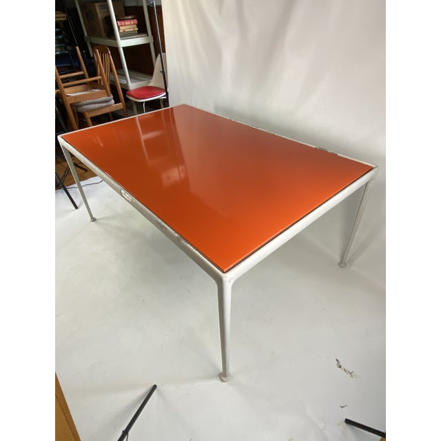 This is a very nice Bright orange porcelain top aluminum frame knoll indoor or outdoor table. Table is original and from...