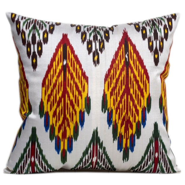 A pair of handmade Silk Atlas Ikat pillows with a linen/cotton natural back. Pillows have a hidden zipper. A down feather...