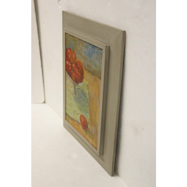 A brightly colored tomato still life painting on stretched linen, displayed in a graywash wood frame. Signed upper right...