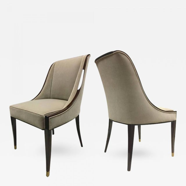 E.J. RUHLMANN Stamped pair of solid Macassar chairs with refined details. Newly French polished and reupholstered in grey...